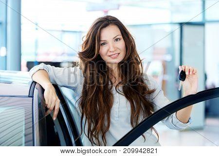 Sitting man car woman taking keys while