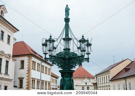 Sights of Prague. Beautiful complex of lanterns with sculptures in historic center of the city