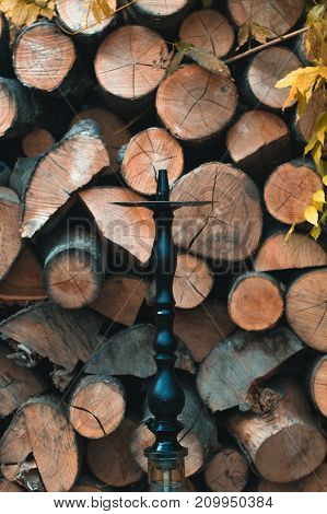 Hookah on a wooden background in the autumn afternoon