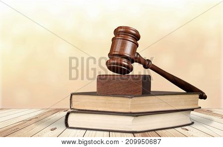 Wooden books gavel table background paper closeup