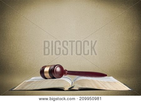 Wooden book hammer judge objects background brown