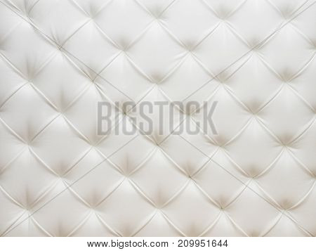 Background image of the white leather with pins
