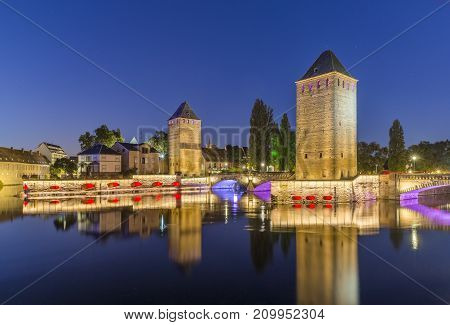 Evening panorama of Strasbourg, the medieval bridge Ponts Couverts, France