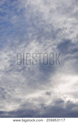 Blue sky with dense white and grey cloud cover.