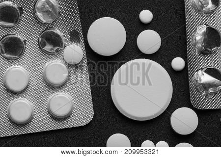 Disease concept. No to drugs and pills concept. Packaging of tablets and pills on the table. Pills addict in the vintage dark tone as Medicine background.