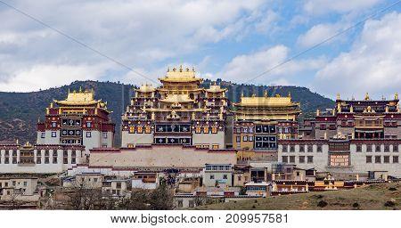 Songzanlin Tibetan Buddhist Monastery, Zhongdian, Yunnan - China. Songzanlin Temple also known as the Ganden Sumtseling Monastery, is a Tibetan Buddhist monastery in Zhongdian city Shangri-La.