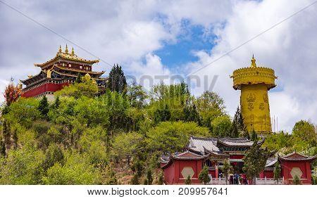 Giant tibetan prayer wheel and Zhongdian temple in Shangri-la - Yunnan privince, China. Worlg biggest prayer wheel.