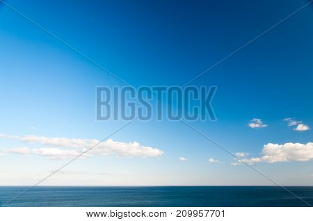 Minimalistic seascape background. Sunny day at the sea.