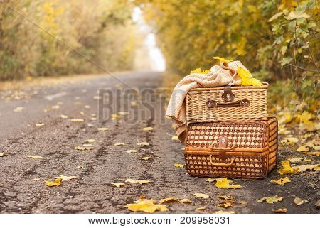 bag on side road background, travel suitcase concept, copy space