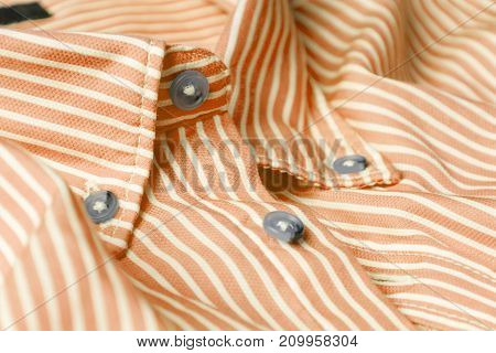 Close up view of a generic orange business shirt with a line pattern