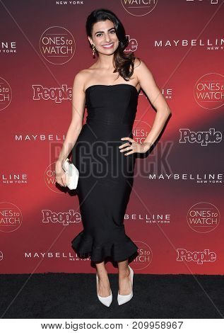 LOS ANGELES - OCT 04:  Claudia Doumit arrives for the People's 'One's To Watch' Event on October 4, 2017 in Hollywood, CA