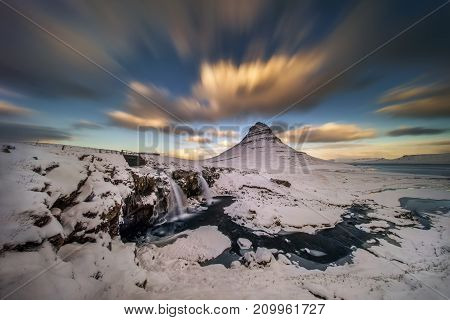 Colorful sunset at Kirkjufell mountain and waterfalls Iceland