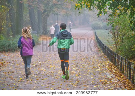 People running in the fog