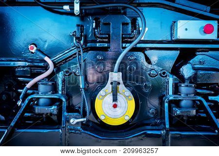 Mechanical parts of engine. Industrial background in blue tone