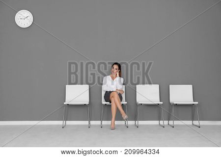 Young woman waiting for job interview in hall