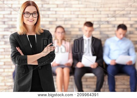 Young woman and blurred people on background