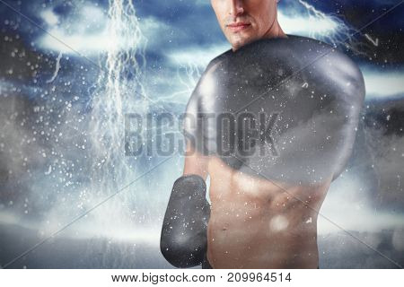 Portrait of boxer performing boxing stance against digitally generated image of color powder