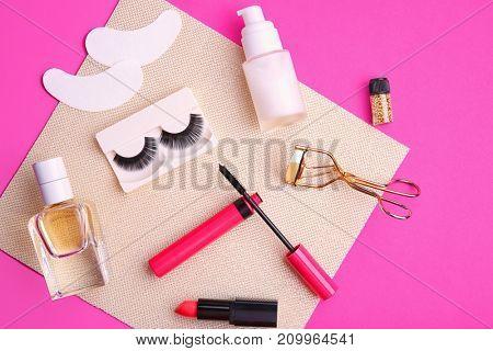 Set with false eyelashes on color background