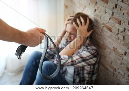 Young woman subjecting to violence in room