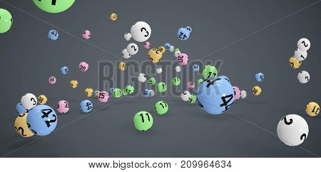Falling colourful lottery balls  against dark grey background
