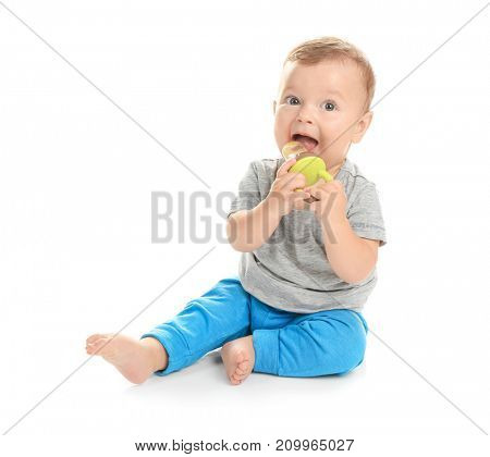 Adorable little baby with nibbler on white background