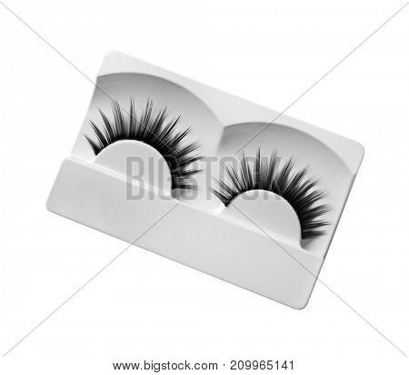 False eyelashes on light background