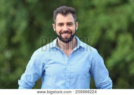 Handsome man in green park