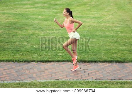 Sporty young woman running in park