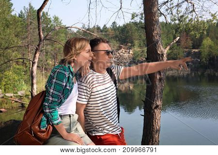 Young lovely couple spending time outdoors