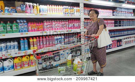Grandma (my mother) pushing a shopping cart at Makro Sainoy branch Bangbuathong provice Thailand Asia 17 October 2017 12: 59 PM.