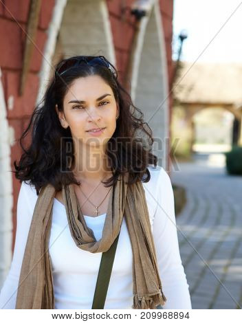 Portrait of authentic smiling woman outdoor. Natural lights.