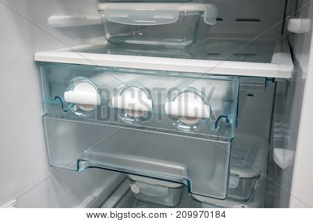 Closed Up White Side By Side Ice Maker And Ice Tray