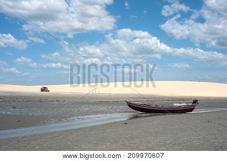 Jericoacoara Ceara state Brazil - July 22 2016: Buggy with tourists traveling through the desert Jericoacoara National Park