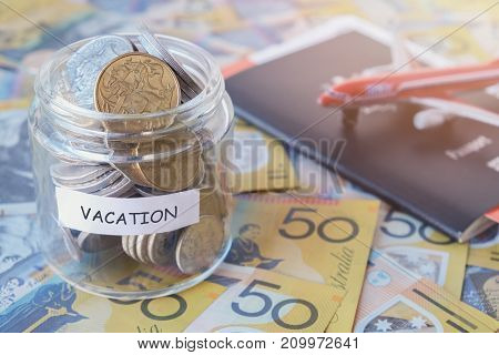 Australian money in VACATION jar with passport