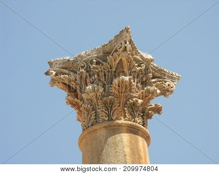 Closeup of a top of a roman column in the ruins of the old city of Jerash in Jordan