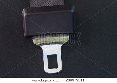 Seat belt on a black leather in a car Safety Concept