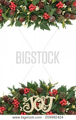 Christmas decorative background border with gold joy decoration, holly, ivy, mistletoe, fir and pine cones on white.