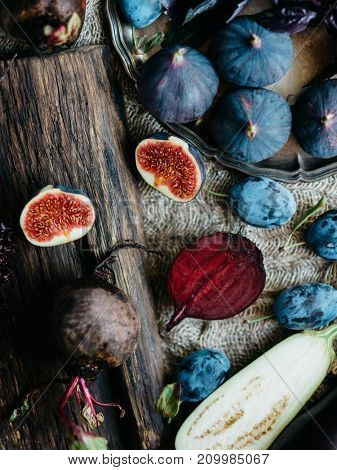 Naturally blue and purple vegetables and fruits. Eggplants, plums, figs and beetroot