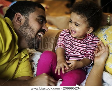 Dad playing with little baby daughter