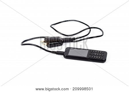 mobile or smartphone with charger on white background