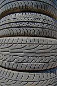 Stacks of old rubber tires background texture. poster