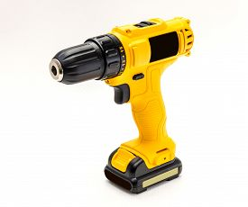 Yellow electric drill cordless on white background