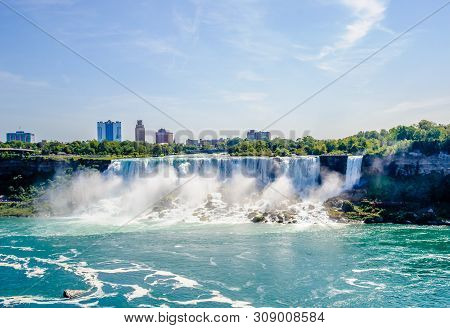 Niagara Falls, Canada - August 27, 2017: The American Falls And Nearby Buildings Are Visible From Ac