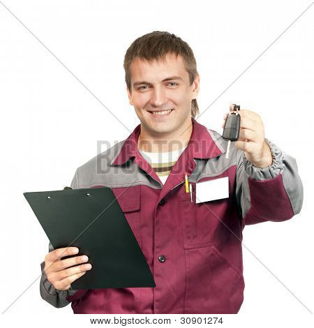 Mechanic with clipboard giving a car key. Isolated on white