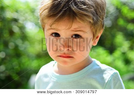 Sad Child, Close-up Portrait. A Frustrated Child Without Mood. Sad Emotions On A Beautiful Face. Chi