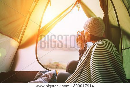 Morning In Temt Camp.woman With Cup Of Hot Tea Sit In Camping Tent