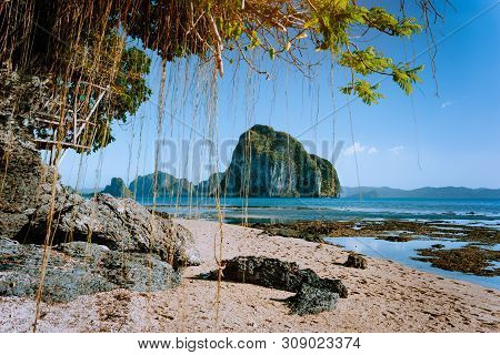 Philippines Natural Scenery Beach At Low Tide, Wooden Bower At The Tree, Amazing Pinagbuyutan Island