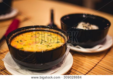 Tom Yam Kong Or Tom Yum, Tom Yam Is A Spicy Clear Soup Typical In Thailand And No.1 Thai Dish Cuisin