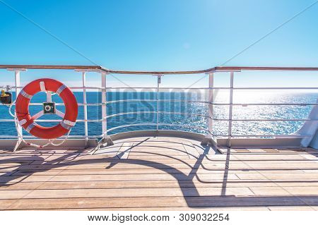 Cruise Ship Wooden Deck And Lifebuoy Ling. Ocean Liner Theme.
