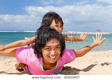 Asian Mother And Child Playing At The Beach